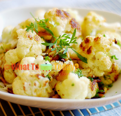 GARLIC-ROASTED CAULIFLOWER WITH PINE NUTS