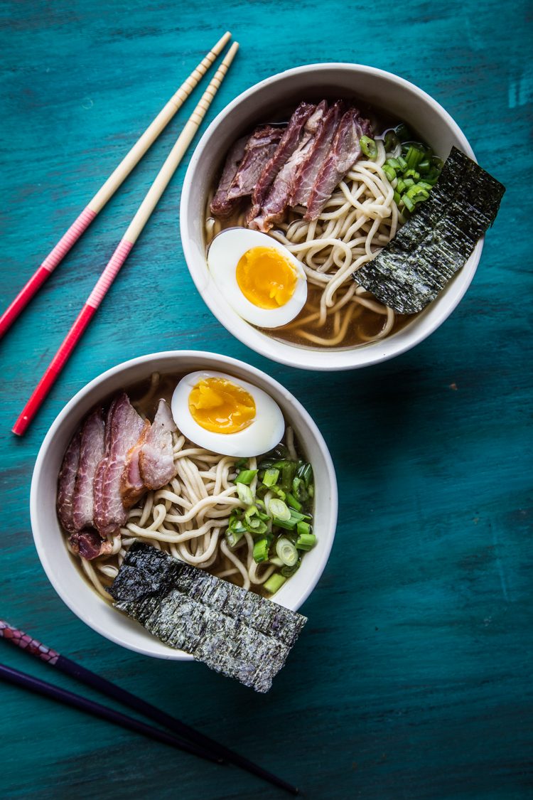 Shoyu ramen is Japanese style noodle soup served in clear dark broth (flavored with shoyu/soy sauce) and toppings like meat, soft-boiled eggs, seaweed, menma (bamboo shoots), etc. Served in homemade ramen noodles is even better.