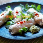STEAMED RICE PAPER-WRAPPED SALMON WITH MACADAMIA NUTS PESTO