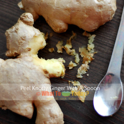 PEELING GINGER WITH A SPOON