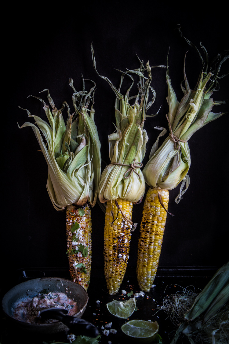 Grilled Oaxacan-style Corn.The savory, creamy, spicy and that zing from the lime give take these corn to the next level