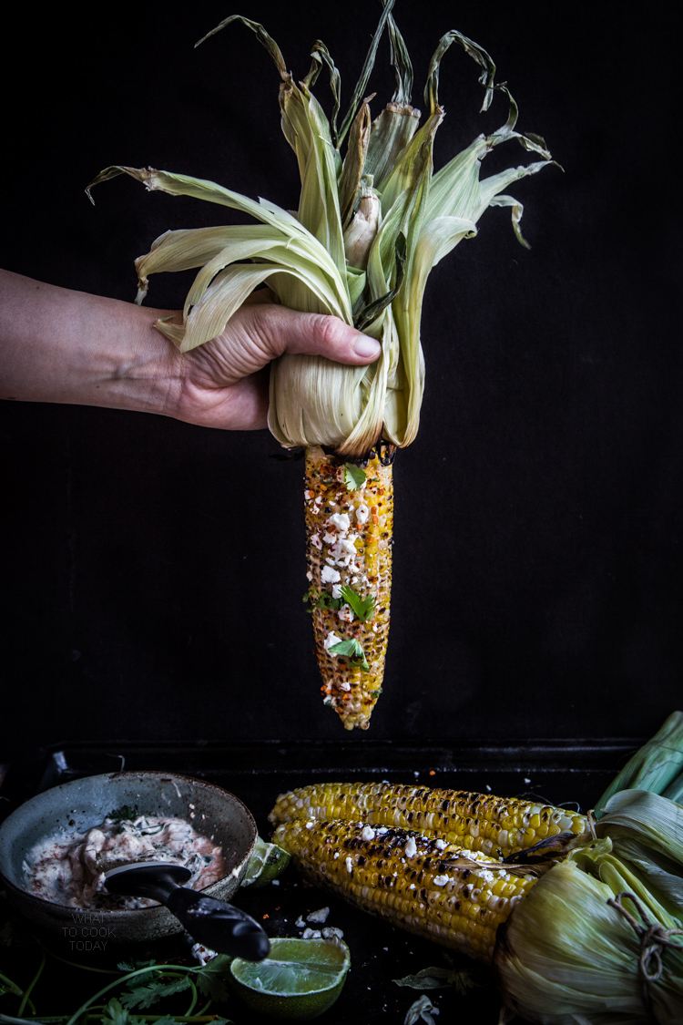 Grilled Oaxacan Corn.The savory, creamy, spicy and that zing from the lime give take these corn to the next level
