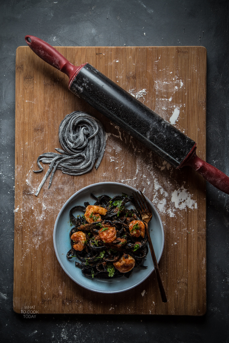 Homemade squid ink pasta with shrimp and garlicky tomato sauce