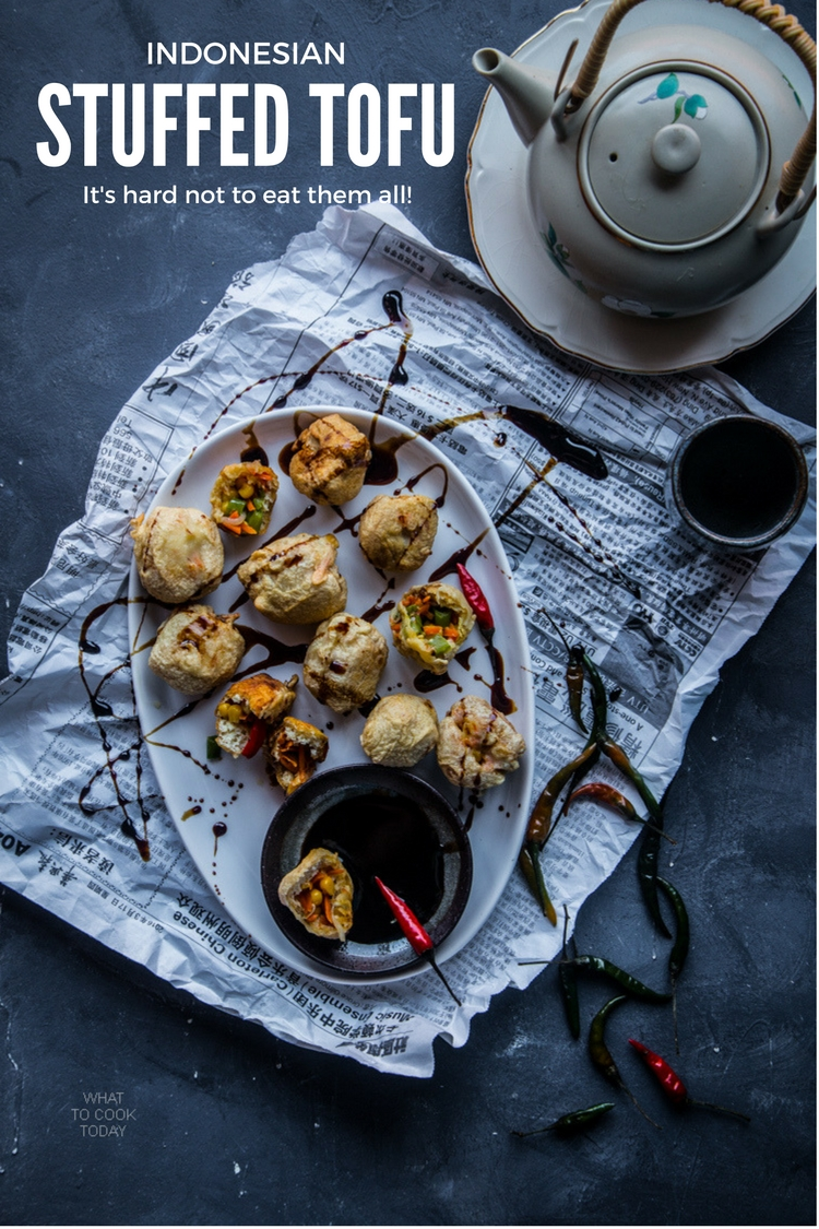 Indonesian stuffed tofu (Tahu isi).Stuffed with vegetable and ground meat and shrimp and deep-fried. It's hard to resist this popular Indonesian snacks