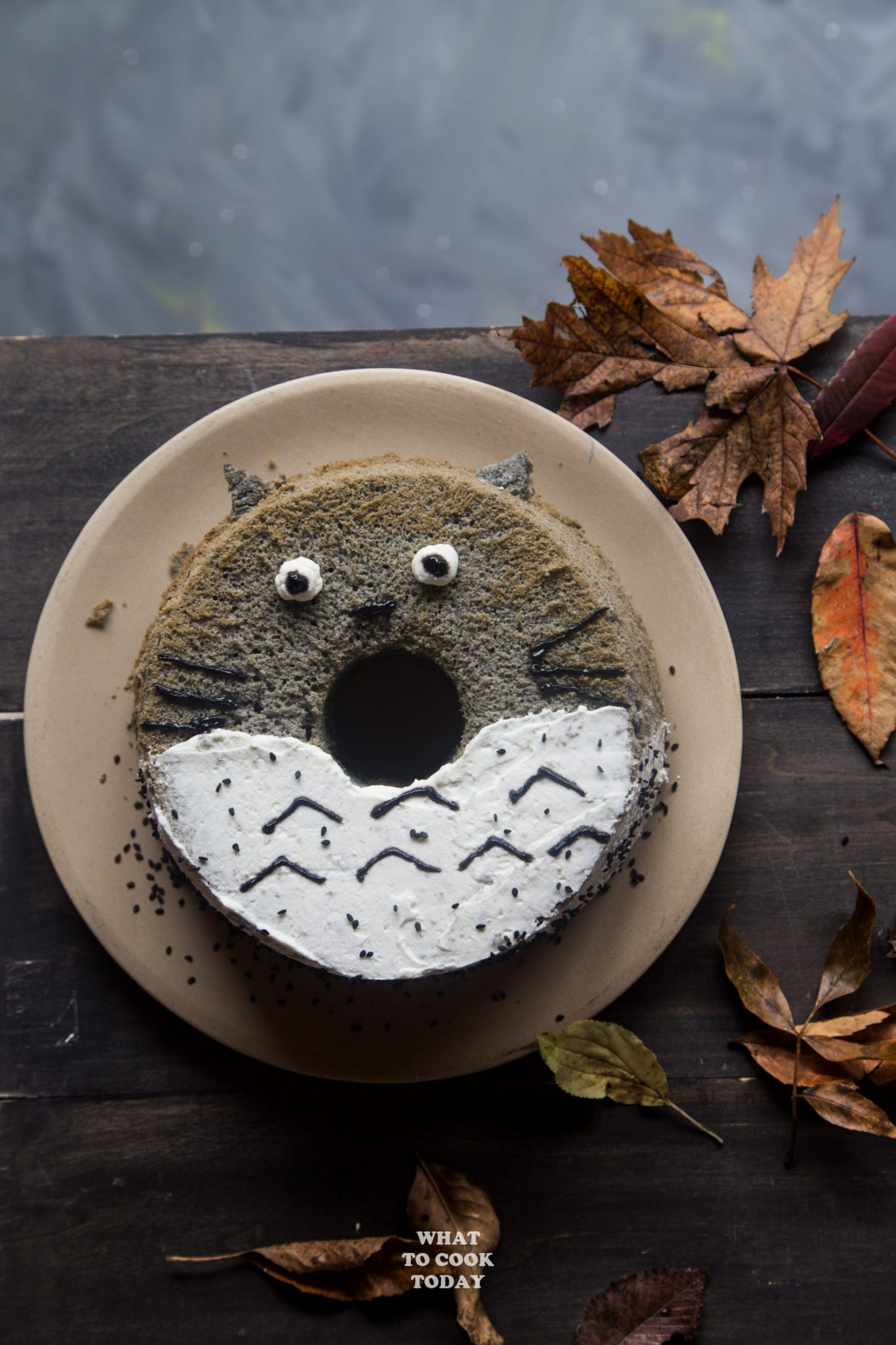 Totoro Black Sesame Chiffon Cake. Perfect for a birthday or as cute Halloween treat. Nutty roasted black sesame seeds are infused all over this light and fluffy chiffon cake that resembles the adorable Japanese anime Totoro