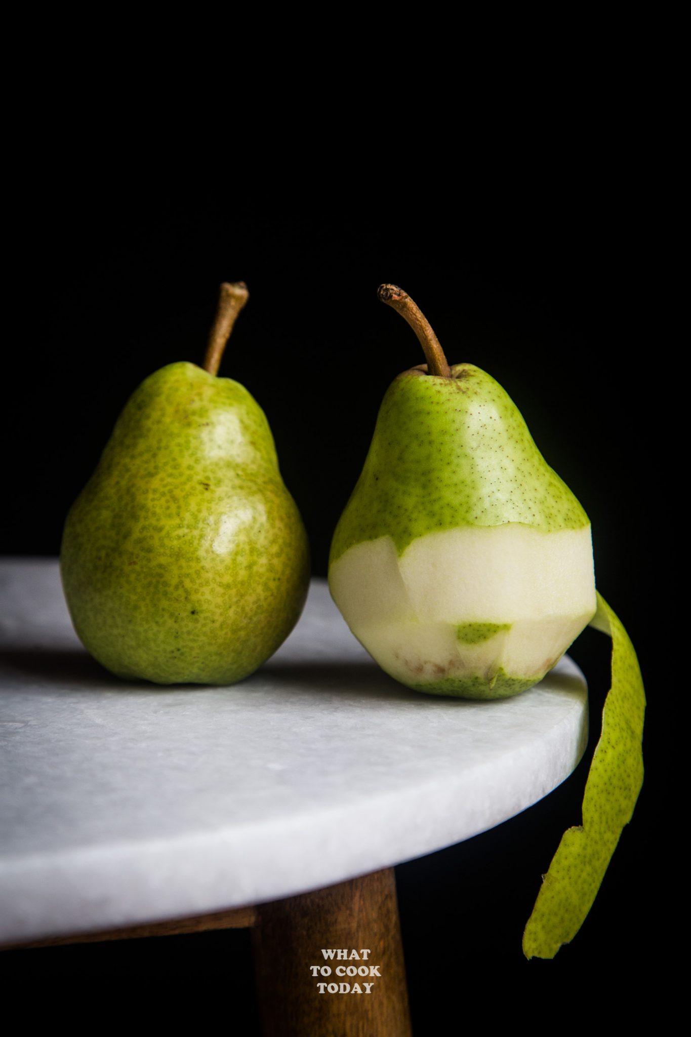 2 pears with 1 half peeled