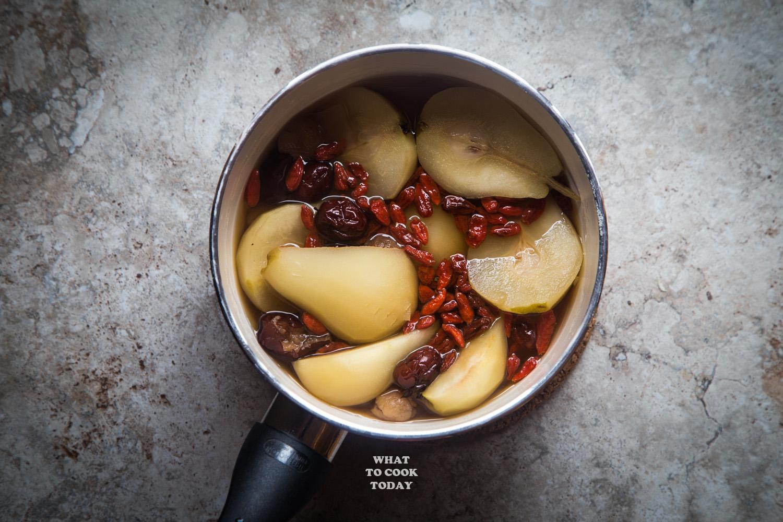 longan, red dates, goji berries poached pears in a medium saucepan