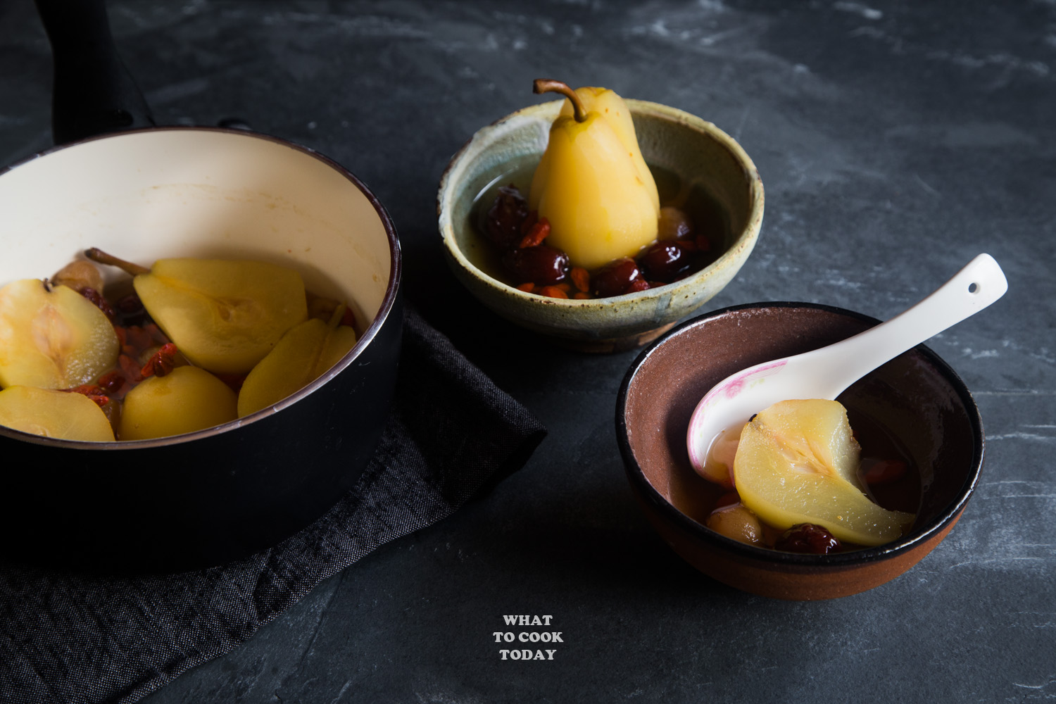 longan, red dates, goji berries poached pears with the pear half-eaten