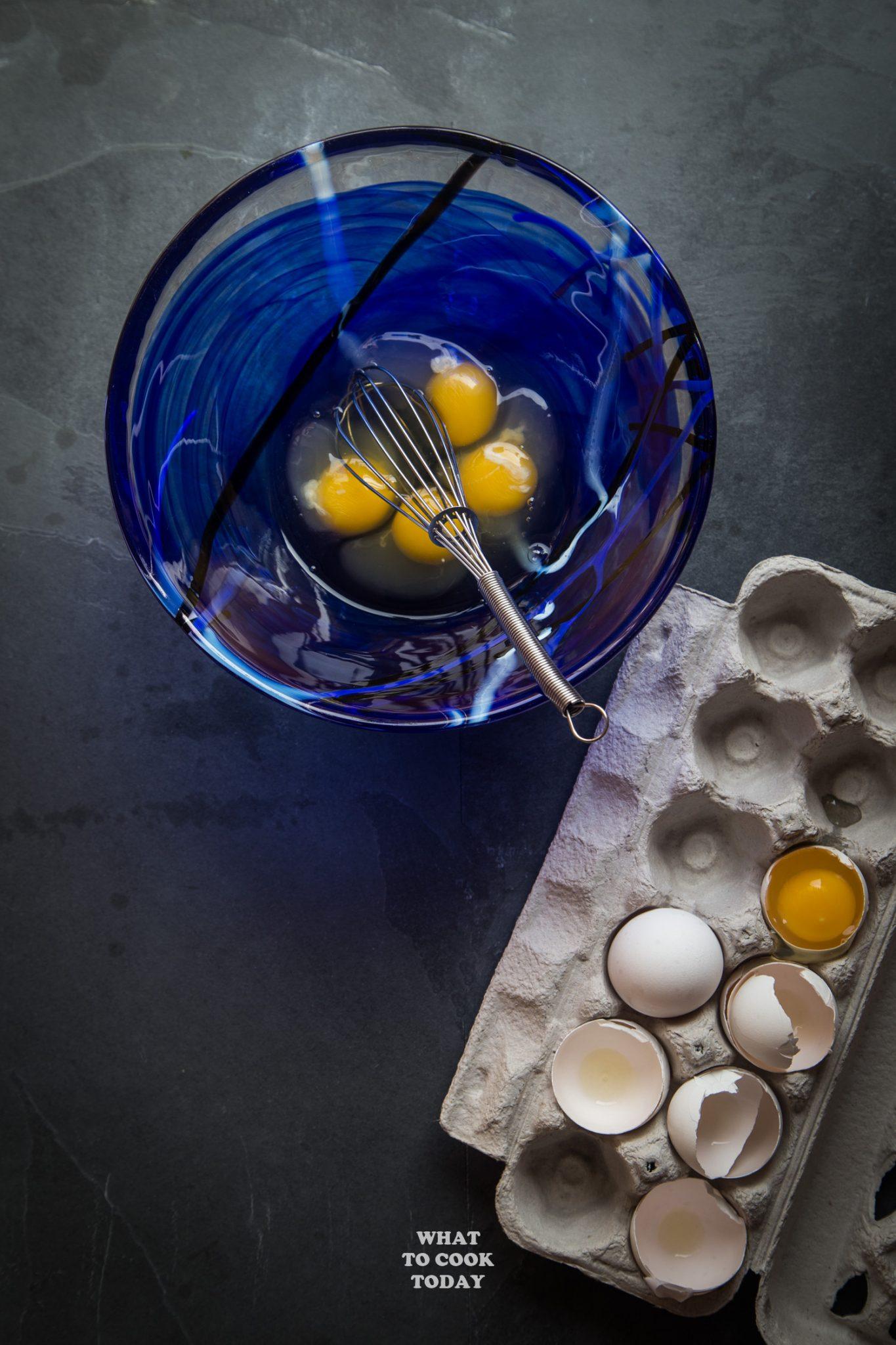 4 cracked eggs flatlay