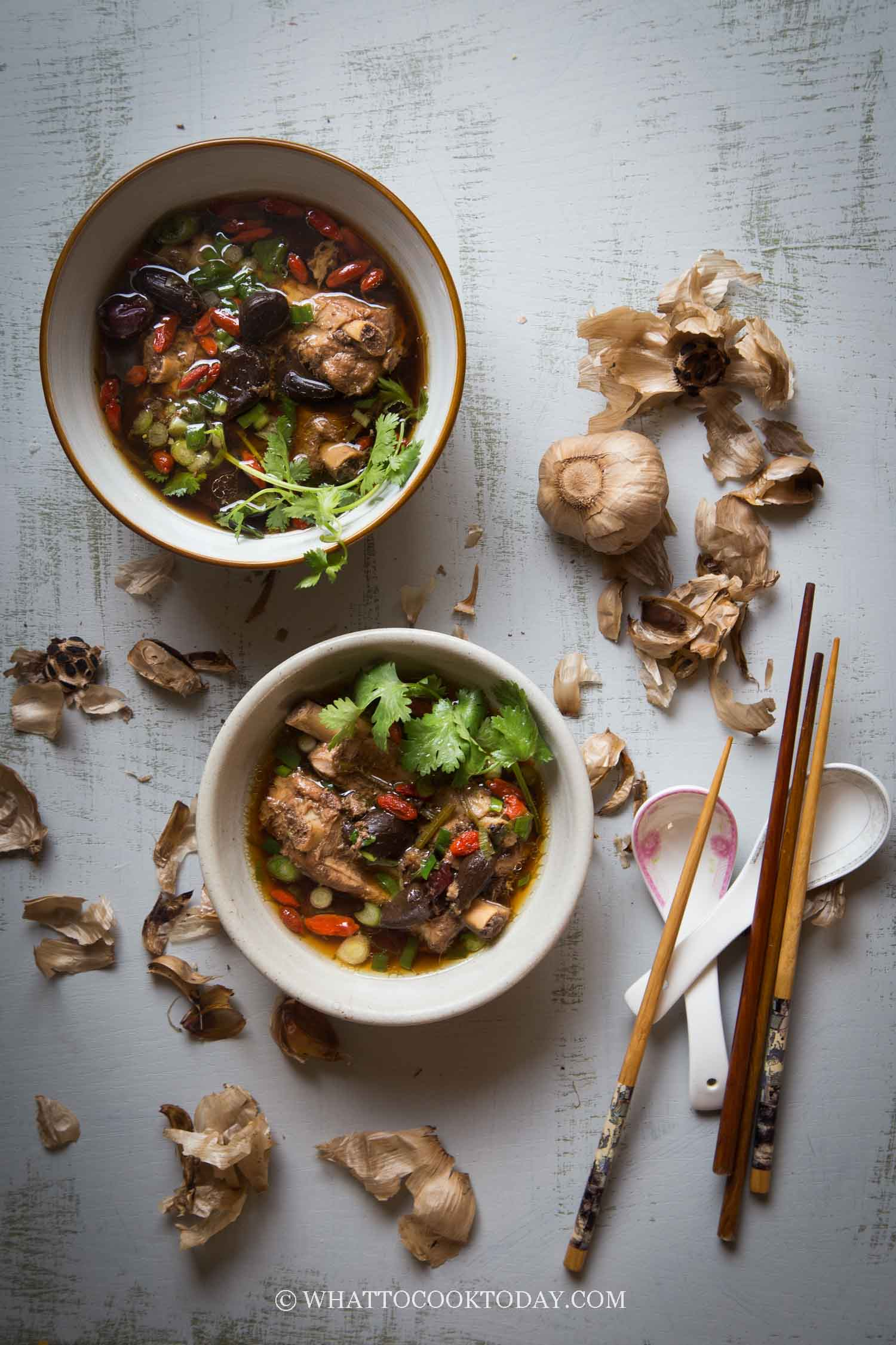 Pressure Cooker Black Garlic Pork Ribs Soup - Comforting and hearty pork ribs soup is flavored with the aromatic and sweet black garlic and Chinese herbs. This is an easy no-fuss soup recipe perfect for everyday home cooking.